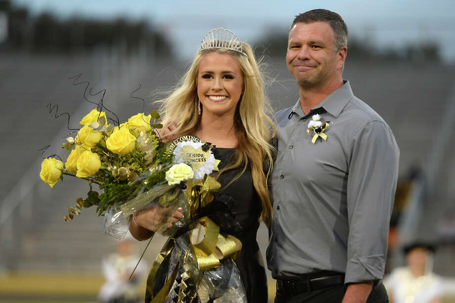 Abbey Montalvo with father Mike Montvalo after being crowned homecoming queen before Nederland's homecoming game against Ozen on Friday night.  Photo taken Friday 10/20/17 Ryan Pelham/The Enterprise Photo: Ryan Pelham / ©2017 The Beaumont Enterprise/Ryan Pelham