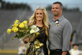 Abbey Montalvo with father Mike Montvalo after being crowned homecoming queen before Nederland's homecoming game against Ozen on Friday night.  Photo taken Friday 10/20/17 Ryan Pelham/The Enterprise