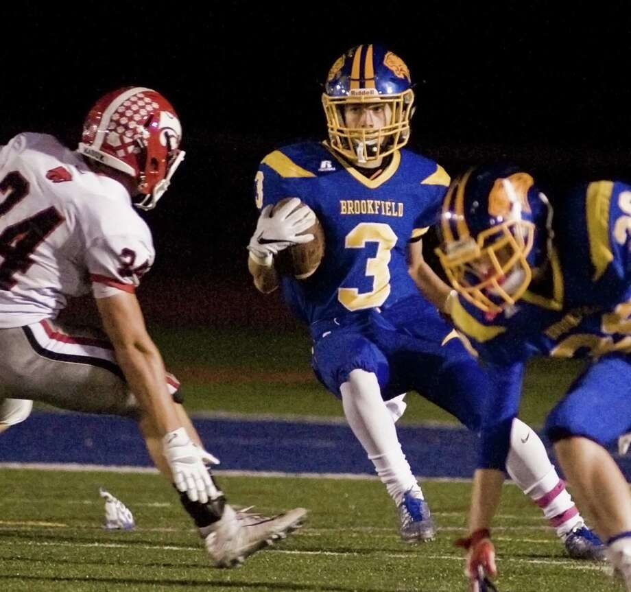 Brookfield High School's Trevor Sterry looks for an opening in a game against Masuk High School, played at Brookfield. Friday, Oct. 20, 2017 Photo: Scott Mullin / For Hearst Connecticut Media / The News-Times Freelance
