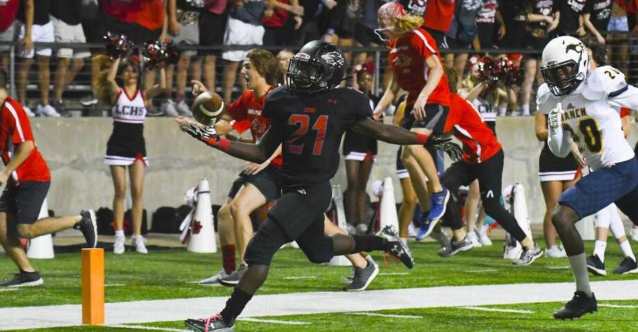 Langham Creek's No.21 Chris Mehn ran a 20-yard touchdown for Langham's first score.           . Photo: Tony Gaines/ HCN