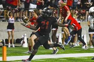 Langham Creek's No.21 Chris Mehn ran a 20-yard touchdown for Langham's first score.           .
