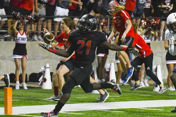 Langham Creek's No.21 Chris Mehn ran a 20-yard touchdown for Langham's first score.           .