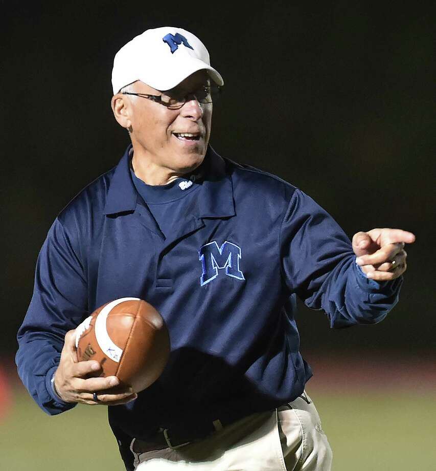 Middletown assistant coach Phil Pessina retrieves the Dragons game ball against E.O. Smith, Friday, October 20, 2017, at Rosek-Skubel Stadium at Middletown High School. Middletown won, 55-7. Photo: Catherine Avalone, Hearst Connecticut Media / New Haven Register