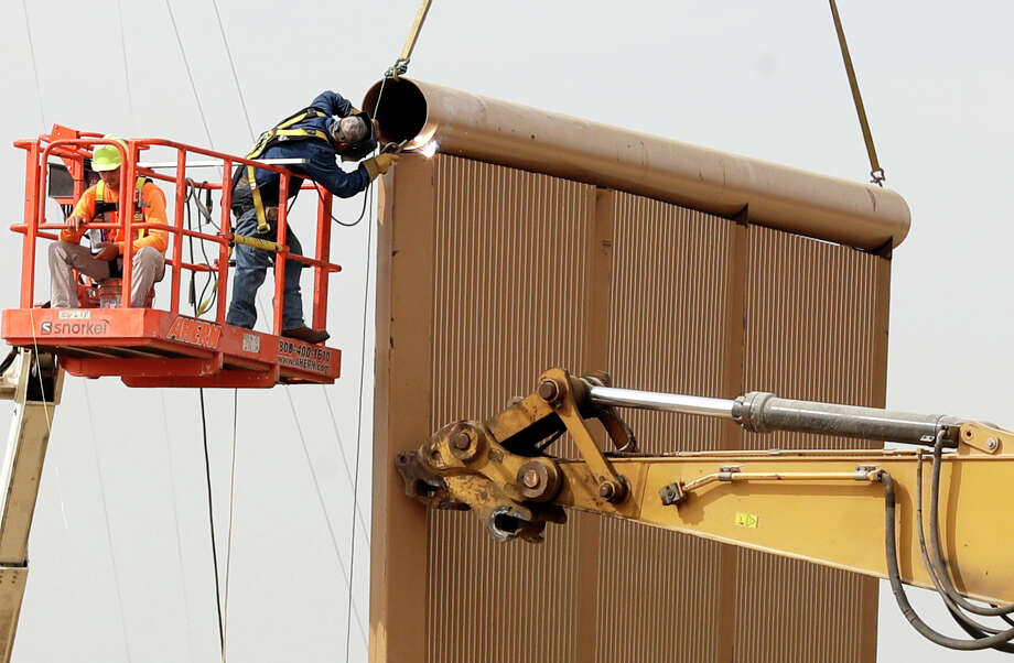 Crews work this week on a border wall prototype near the border with Tijuana. Companies are nearing Thursday's deadline to finish building eight prototypes of President Donald Trump's proposed wall. Photo: Gregory Bull, STF / Copyright 2017 The Associated Press. All rights reserved.
