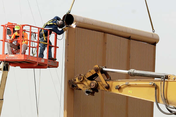 Crews work this week on a border wall prototype near the border with Tijuana. Companies are nearing Thursday's deadline to finish building eight prototypes of President Donald Trump's proposed wall.