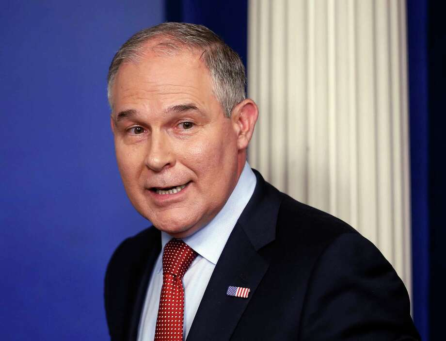 FILE - In this June 2, 2017 file photo, EPA Administrator Scott Pruitt looks back after speaking to the media during the daily briefing in the Brady Press Briefing Room of the White House in Washington.   Pruitt is looking to make peace on biofuels standards with a group of senators from corn-growing states who could upend President Donald Trump's nominees for key regulatory posts. Pruitt pledged in a letter to Sen. Joni Ernst of Iowa and a half dozen other Republican lawmakers to take specific actions benefiting the biofuels industry. (AP Photo/Pablo Martinez Monsivais, File) Photo: Pablo Martinez Monsivais, STF / Copyright 2017 The Associated Press. All rights reserved.