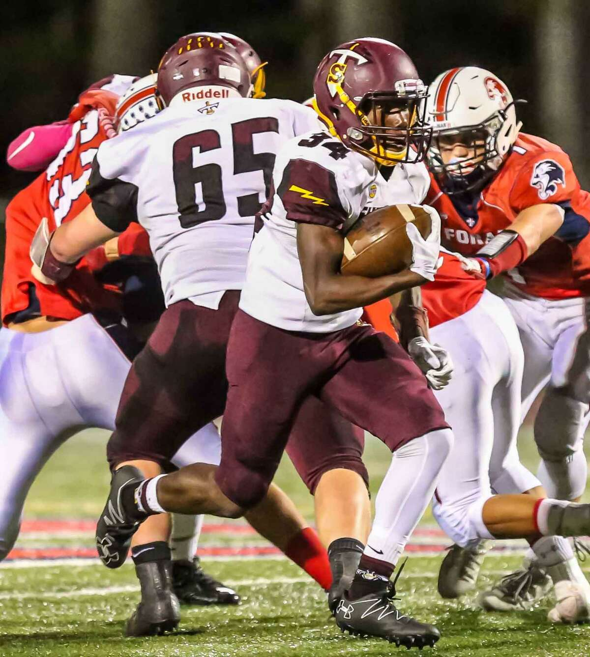 Sheehan's Terrance Bogan gets past the Foran defense for a a touchdown during Friday's game in Milford.