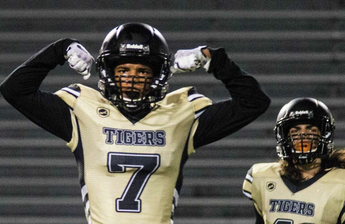 Conroe's Alex Morrison celebrates after a big hit against College Park on Friday at Moorhead Stadium in Conroe.