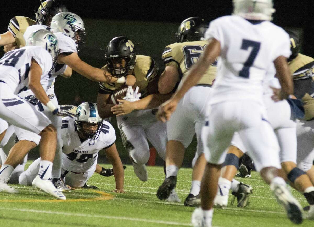 Conroe running back Donaven Lloyd is grabbed in the hole against College Park on Friday at Moorhead Stadium in Conroe.
