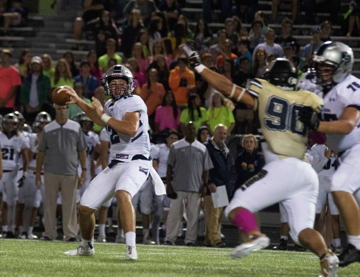 College Park quarterback Jake Hunnicutt winds up for a pass against Conroe on Friday at Moorhead Stadium in Conroe.