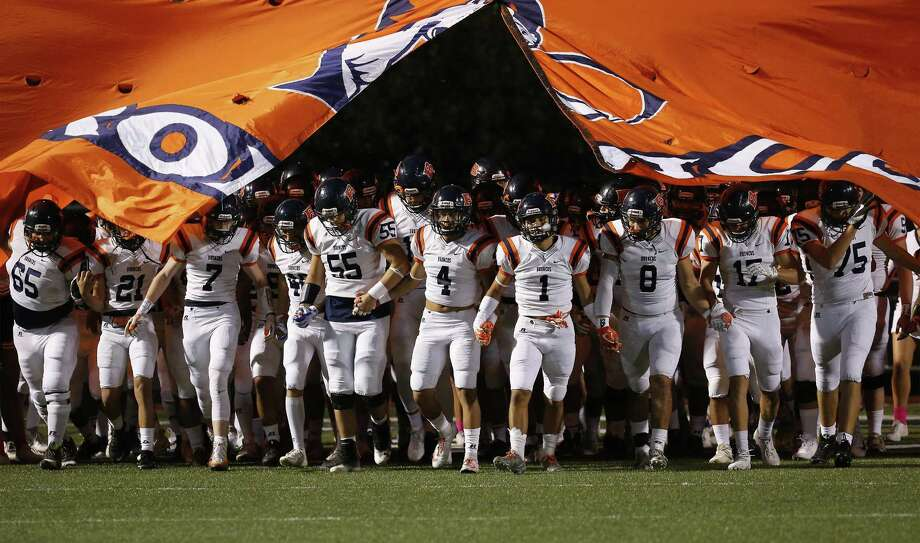 The Brandeis Broncos take the field for the game against Brennan during District 28-6A high school football at Dub Farris Stadium on Friday, Oct. 20, 2017. (Kin Man Hui/San Antonio Express-News) Photo: Kin Man Hui, Staff / San Antonio Express-News / ©2017 San Antonio Express-News