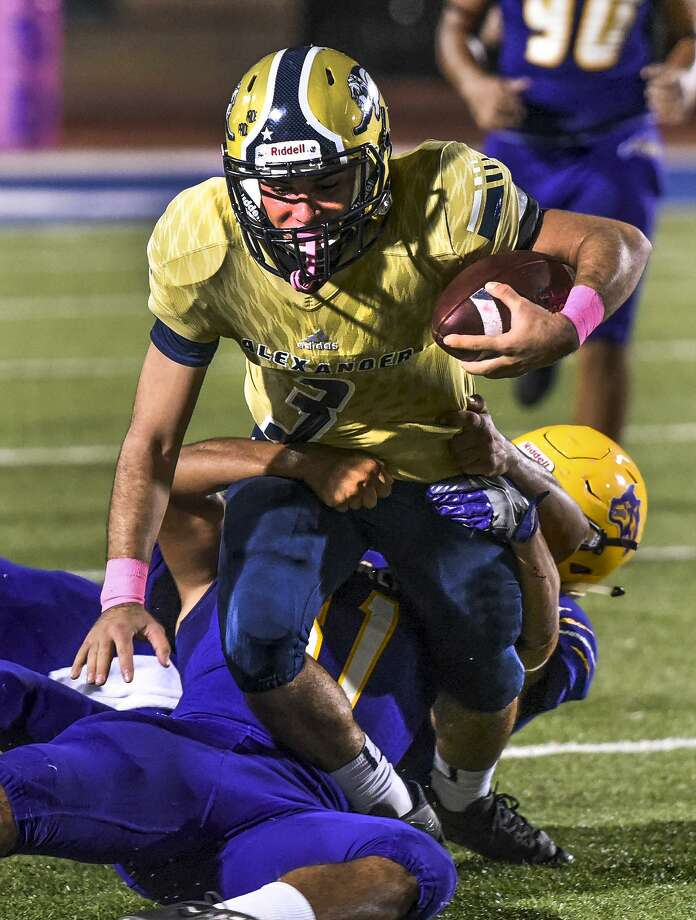 Alexander High School Camilo Pedraza runs the ball as the Lyndon B. Johnson High School defense tries to take him down on Friday, Oct. 20, 2017, at the Student Activity Complex. Photo: Danny Zaragoza /Laredo Morning Times File