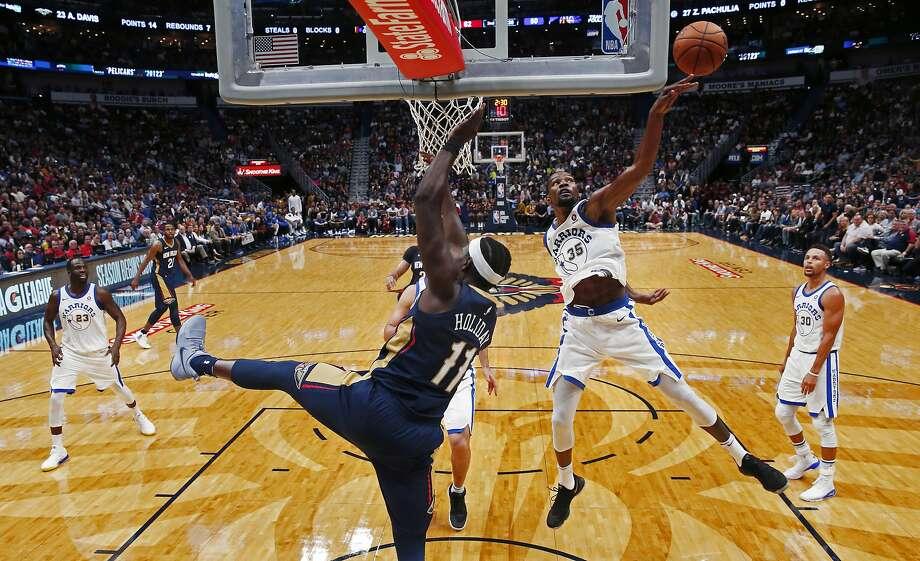 Golden State Warriors forward Kevin Durant (35) blocks a shot by New Orleans Pelicans guard Jrue Holiday (11) in the first half of an NBA basketball game in New Orleans, Friday, Oct. 20, 2017. (AP Photo/Gerald Herbert) Photo: Gerald Herbert, Associated Press