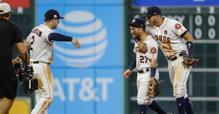 Houston Astros third baseman Alex Bregman (2), second baseman Jose Altuve (27) and shortstop Carlos Correa (1) celebrate the Astros win at the end of the ninth inning of Game 6 of the ALDS at Minute Maid Park, Friday, Oct. 20, 2017, in Houston. ( Karen Warren / Houston Chronicle ) Photo: Karen Warren/Houston Chronicle