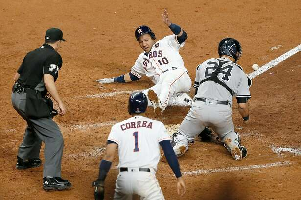 HOUSTON, TX - OCTOBER 20:  Yuli Gurriel #10 of the Houston Astros celebrates as he slides home to score off of a double hit by Alex Bregman #2 against David Robertson #30 of the New York Yankees during the eighth inning in Game Six of the American League Championship Series at Minute Maid Park on October 20, 2017 in Houston, Texas.  (Photo by Bob Levey/Getty Images)