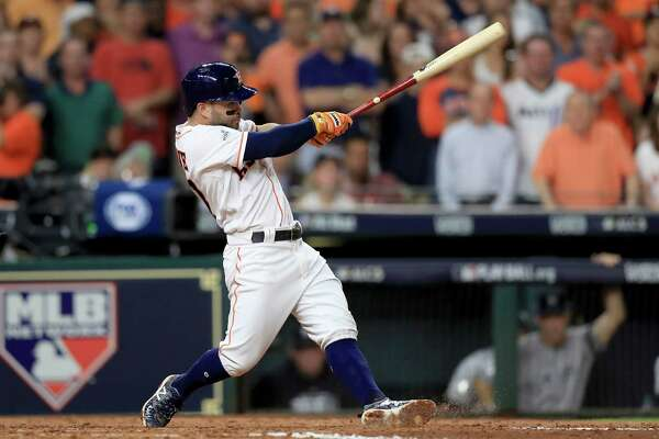 HOUSTON, TX - OCTOBER 20:  Jose Altuve #27 of the Houston Astros hits a single to left field to score Evan Gattis #11 and Brian McCann #16 against Luis Severino #40 of the New York Yankees during the fifth inning  in Game Six of the American League Championship Series at Minute Maid Park on October 20, 2017 in Houston, Texas.  (Photo by Ronald Martinez/Getty Images) ORG XMIT: 775058088