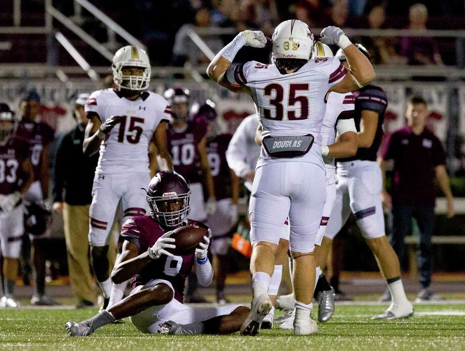 Magnolia West middle linebacker Noah Bryson (35) celebrates after dropping Magnolia wide receiver Michael Woods (8) for a loss during the third quarter of a District 20-5A high school football game, Friday Oct. 20, 2017, in Magnolia. Photo: Jason Fochtman, Staff Photographer / © 2017 Houston Chronicle