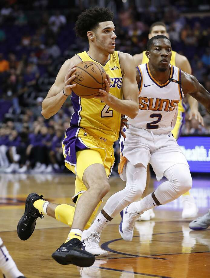 30ad2176f Lakers guard Lonzo Ball drives past Suns guard Eric Bledsoe during the first  half in Phoenix