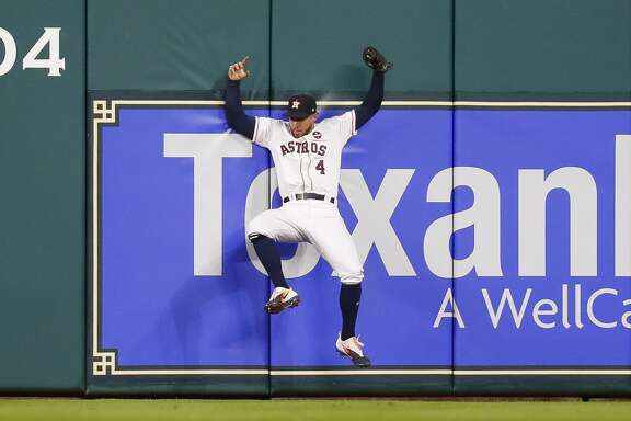 Houston Astros center fielder George Springer (4) catches a fly ball from New York Yankees third baseman Todd Frazier (29) with two runs on base to get the seond out of the seventh inning of Game 6 of the ALDS at Minute Maid Park, Friday, Oct. 20, 2017, in Houston. ( Karen Warren / Houston Chronicle )