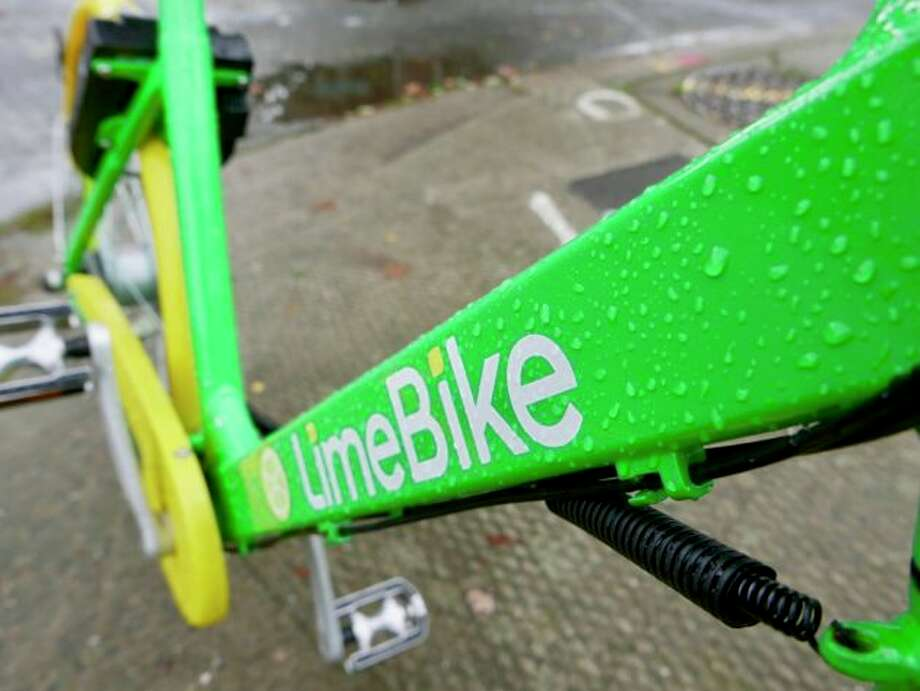 Seattle bike shares are determined to brave the wet winter. Photo: Kurt Schlosser/GeekWire