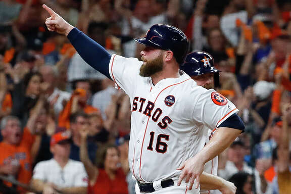 Houston Astros catcher Brian McCann (16) comes home off of a Jose Altuve RBI single during the fifth inning of Game 6 of the ALDS at Minute Maid Park, Friday, Oct. 20, 2017, in Houston. ( Karen Warren / Houston Chronicle )