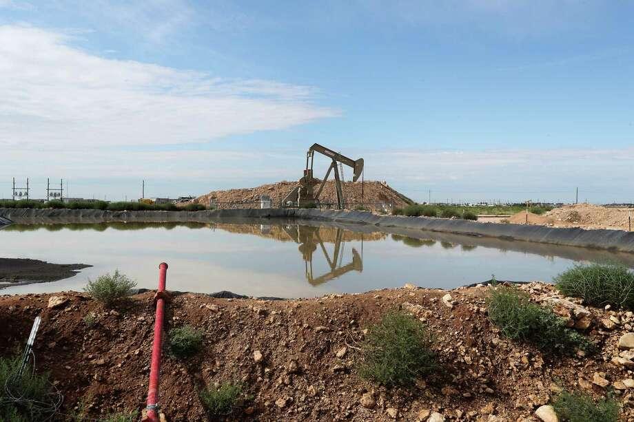 An oil rigs pumps near Halliburton's fracking site Monday, June 26, 2017, in Midland. ( Steve Gonzales  / Houston Chronicle ) Photo: Steve Gonzales, Staff / © 2017 Houston Chronicle