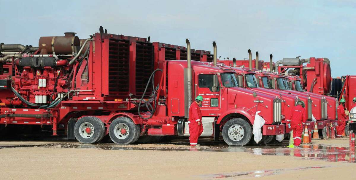 Houston oilfield service giant Halliburton closed two service centers in Texas and laid off another 240 employees in Oklahoma as record low oil prices continue to cut demand for the company's products and services.