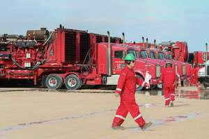 Halliburton hydraulic fracturing pumping units line a row near three pads Monday, June 26, 2017, in Midland.  Halliburton's here in West Texas have set off the second U.S. oil boom in a decade, this time delivering heavier payloads in more prolific regions, and countering efforts by OPEC to curb the world's oil glut and weighing on prices.  ( Steve Gonzales  / Houston Chronicle )