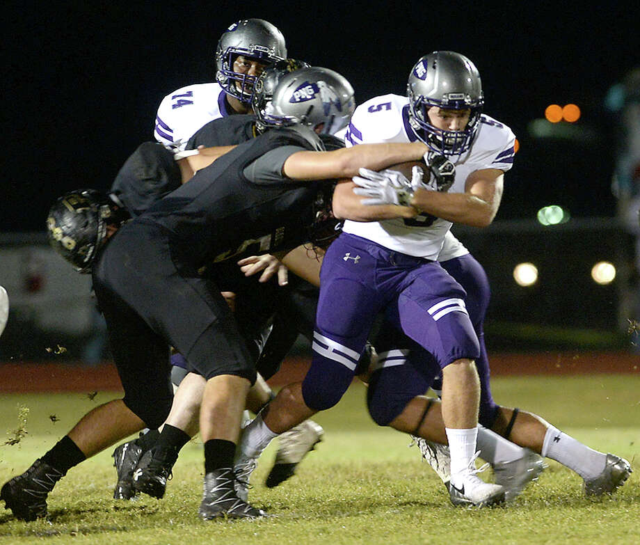 Vidor's defense looks to bring down Port Neches - Groves' Gavin Deslatte during their District 22 - 5A match-up Friday night in Vidor. Photo taken Friday, October 20, 2017 Kim Brent/The Enterprise Photo: Kim Brent / BEN