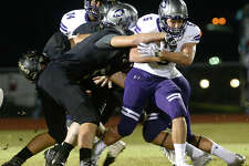 Vidor's defense looks to bring down Port Neches - Groves' Gavin Deslatte during their District 22 - 5A match-up Friday night in Vidor. Photo taken Friday, October 20, 2017 Kim Brent/The Enterprise