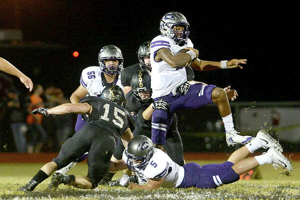Vidor's defense fails to stop Port Neches - Groves' Roschon Johnson as he leaps over to pick up yardage during their District 22 - 5A match-up Friday night in Vidor. Photo taken Friday, October 20, 2017 Kim Brent/The Enterprise