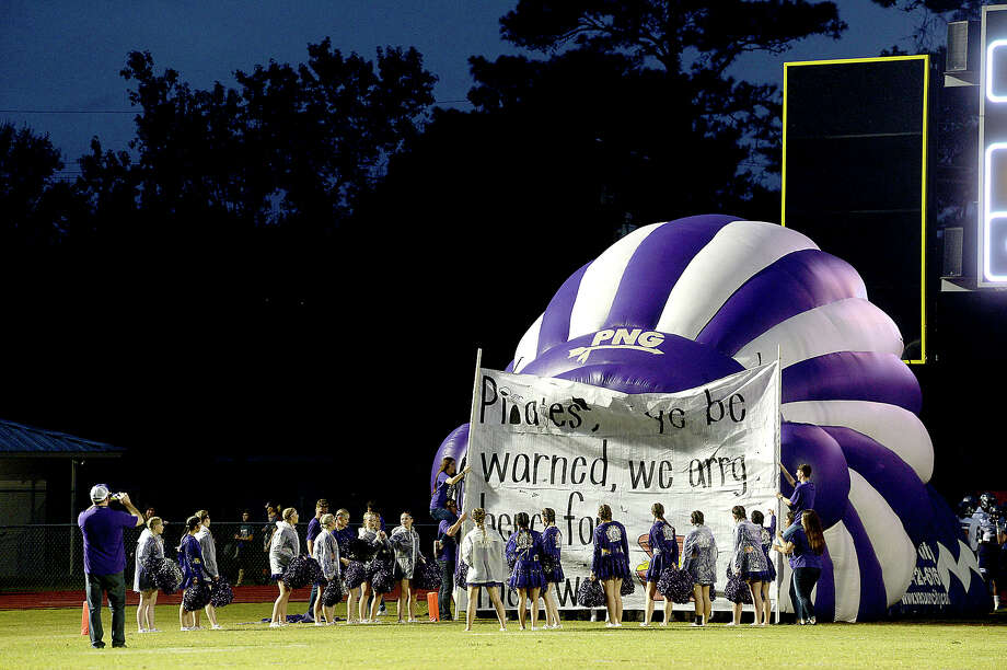 Port Neches - Groves' cheer squad line the inflatable as the Indians get ready for their entry to face the Pirates during their District 22 - 5A match-up Friday night in Vidor. Photo taken Friday, October 20, 2017 Kim Brent/The Enterprise Photo: Kim Brent / BEN