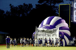 Port Neches - Groves' cheer squad line the inflatable as the Indians get ready for their entry to face the Pirates during their District 22 - 5A match-up Friday night in Vidor. Photo taken Friday, October 20, 2017 Kim Brent/The Enterprise