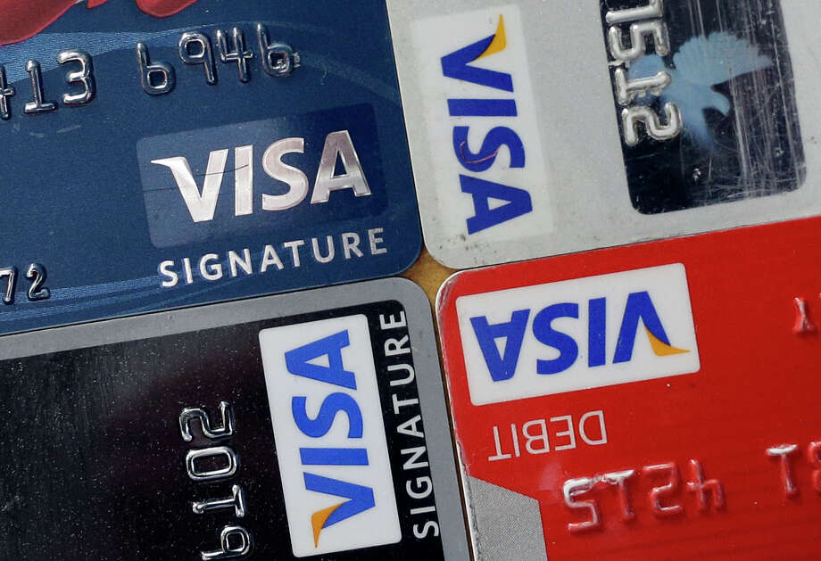 Have your driver's license ready... SB 1381 allows businesses to ask customers for identification when making a transaction with a credit card or debit card. Photo: Patrick Semansky, STF / A20132013