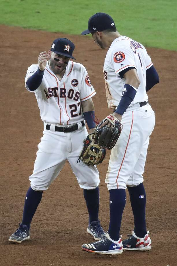 Houston Astros second baseman Jose Altuve (27) and shortstop Carlos Correa (1) celebrate as they beat the New York Yankees 7-1 in Game 6 of the ALCS at Minute Maid Park Friday, Oct. 20, 2017 in Houston. ( Michael Ciaglo / Houston Chronicle) Photo: Michael Ciaglo/Houston Chronicle