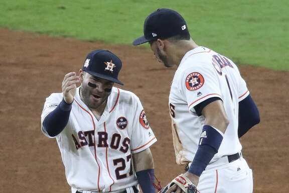 Houston Astros second baseman Jose Altuve (27) and shortstop Carlos Correa (1) celebrate as they beat the New York Yankees 7-1 in Game 6 of the ALCS at Minute Maid Park Friday, Oct. 20, 2017 in Houston. ( Michael Ciaglo / Houston Chronicle)