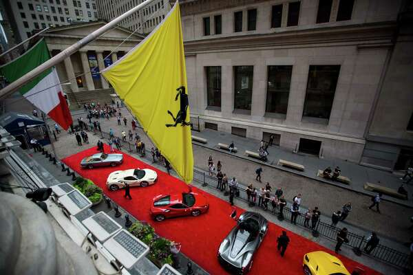 Ferraris sit parked in front of the New York Stock Exchange in New York on Oct. 9, 2017.