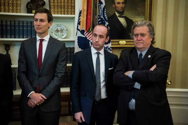 White House senior adviser Jared Kushner, left, senior policy adviser Stephen Miller, and chief strategist Stephen K. Bannon watch as President Donald Trump speaks in the Oval Office of the White House on April 20.