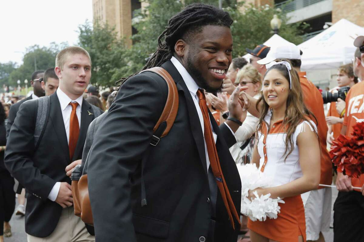 AUSTIN, TX - OCTOBER 21: Malik Jefferson #46 of the Texas Longhorns walks into the stadium prior to the game against the Oklahoma State Cowboys at Darrell K Royal-Texas Memorial Stadium on October 21, 2017 in Austin, Texas.