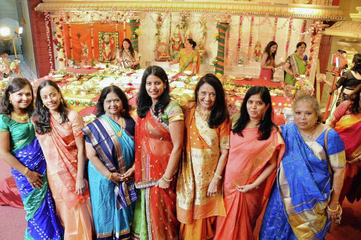 Women pose for a photo during the Hindu Temple Society Of The Capital District's Grand Diwali Celebration Saturday Oct. 21, 2017 in Colonie, NY. (John Carl D'Annibale / Times Union)