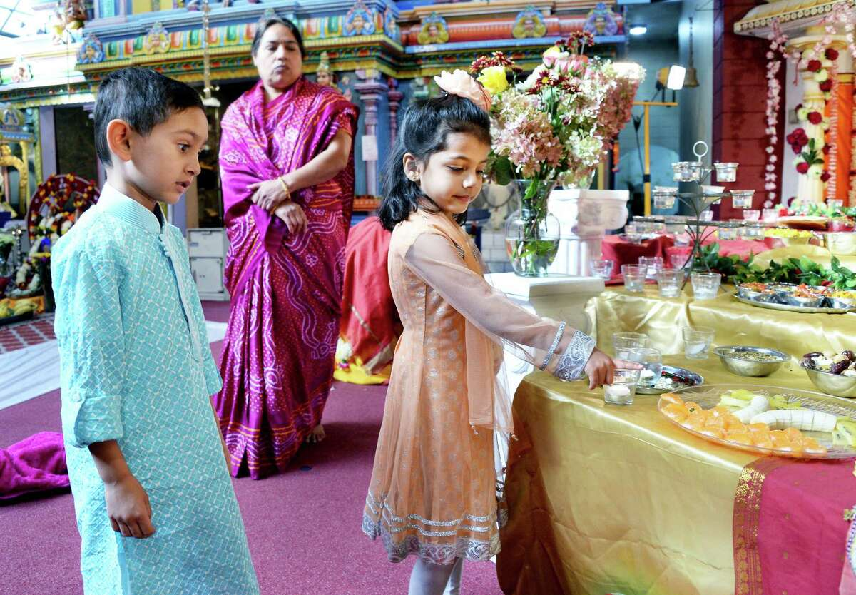 Aarav Mistry, 5, of Bedford, Mass, left, and Aria Patel, 4, of Clifton Park check out food offerings during the Hindu Temple Society Of The Capital District's Grand Diwali Celebrations Saturday Oct. 21, 2017 in Colonie, NY. (John Carl D'Annibale / Times Union)