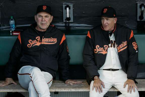 (l-r) Giants' manager Bruch Bochy (15) chats with pitching coach Dave Righetti (19) before a game between the San Francisco Giants and the Milwaukee Brewers at AT&T Park in San Francisco, Calif., on Tuesday, Aug. 22, 2017.