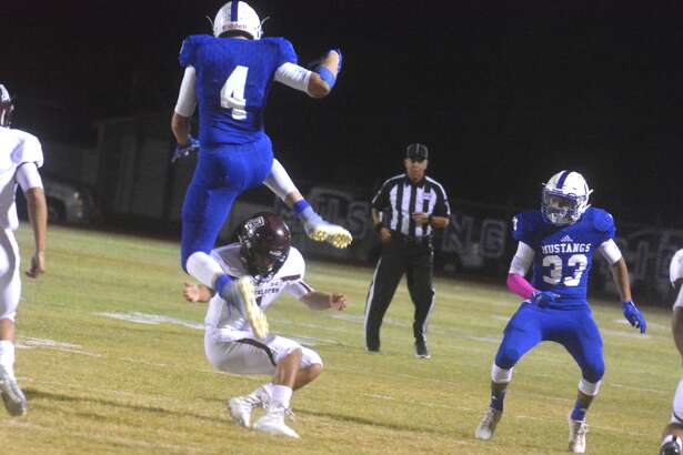 Olton's Zach Ramage, 4, hurdles an Abernathy tackler during the first quarter of a District 2-2A, Division I game at Olton Friday night.