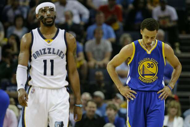 Memphis Grizzlies guard Mike Conley (11) and Golden State Warriors guard Stephen Curry (30) walks the court during a time out in the first half of Game 6 of a second-round NBA basketball Western Conference playoff series Friday, May 15, 2015, in Memphis, Tenn. (AP Photo/Mark Humphrey)