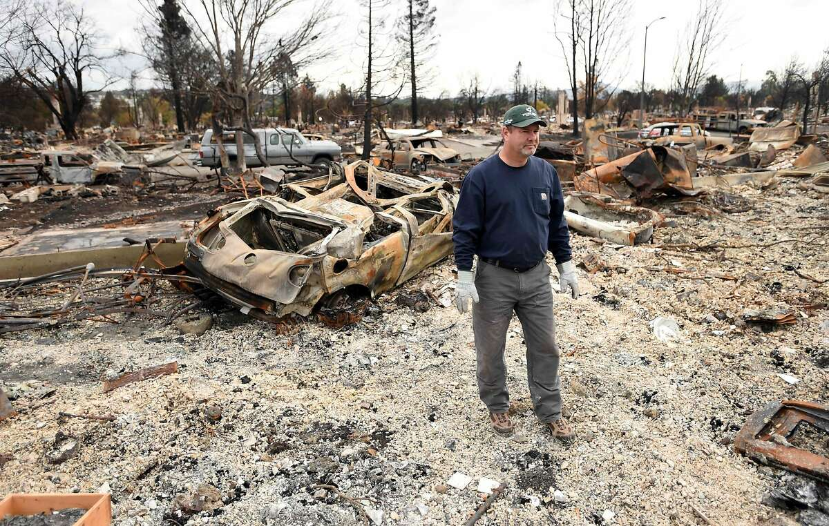 Ray Wilson views his burned home in the Coffey Park area of Santa Rosa, California, on October 20, 2017. Residents are being allowed to return to their burned homes on October 20 to grieve and search through remains. Around 5,700 homes and businesses have been destroyed by the fires, the deadliest in California's history. / AFP PHOTO / JOSH EDELSONJOSH EDELSON/AFP/Getty Images
