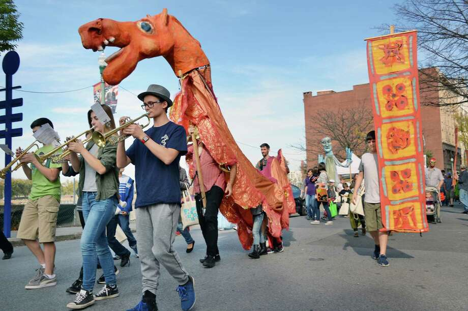 Trumpeters from Columbia High and giant puppets lead the The Arts Center of the Capital Region's Hands on Halloween! parade along River Street Saturday Oct. 21, 2017 in Troy, NY.  (John Carl D'Annibale / Times Union) Photo: John Carl D'Annibale / 20041816A