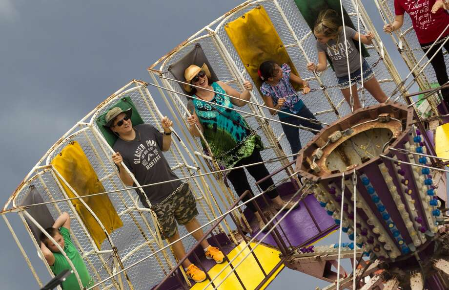 Patrons enjoy a carnival ride during the annual Fire and Ice Festival at Texan Drive Stadium, Saturday, Oct. 21, 2017, in New Caney. Photo: Jason Fochtman/Houston Chronicle
