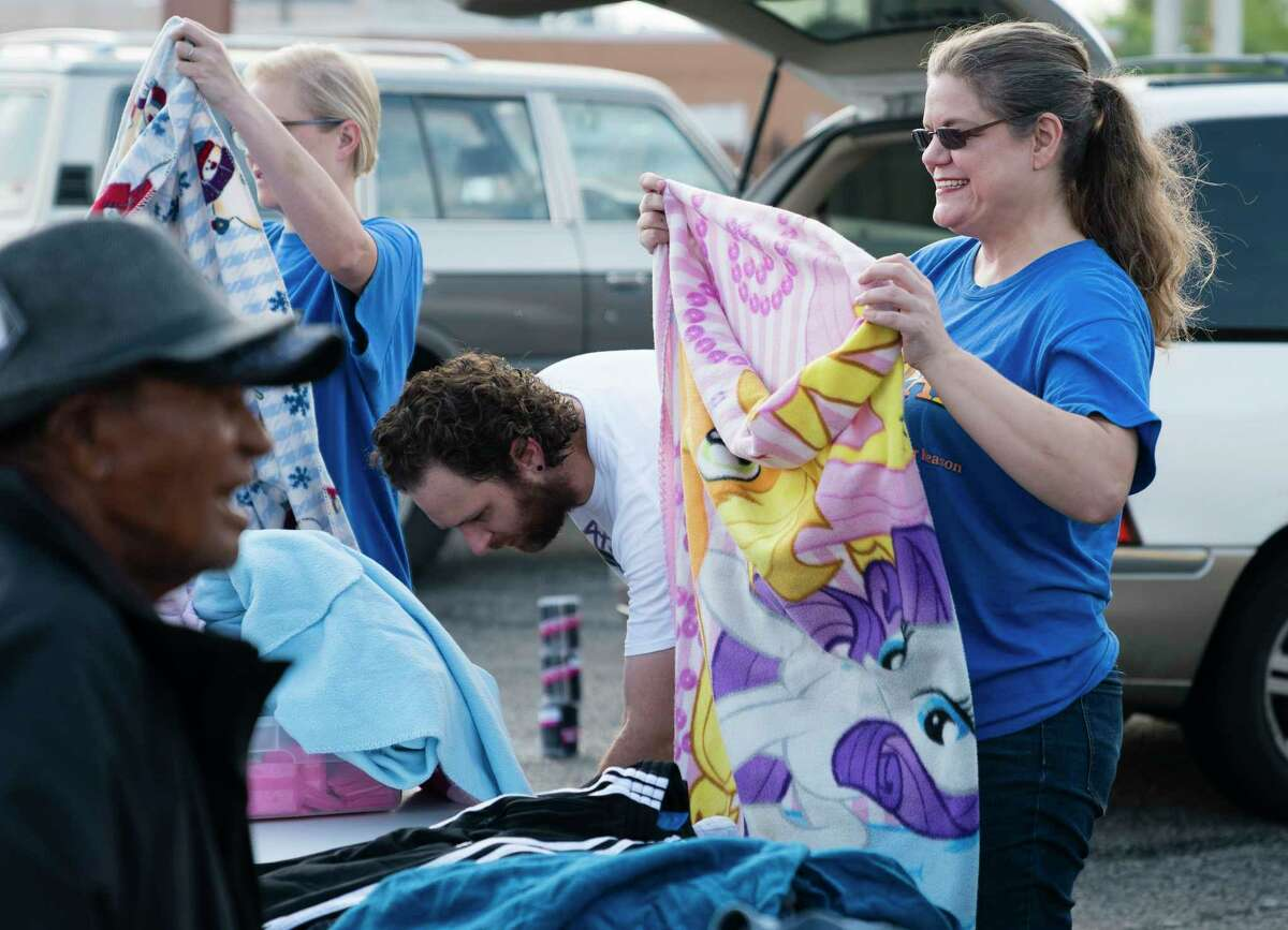 Vicky Gettman, of South Texas Atheists for Reason, hands out supplies and clothing to homeless citizens, Sunday, Sept. 24, 2017, in Downtown San Antonio. (Darren Abate/For the San Antonio Express-News)