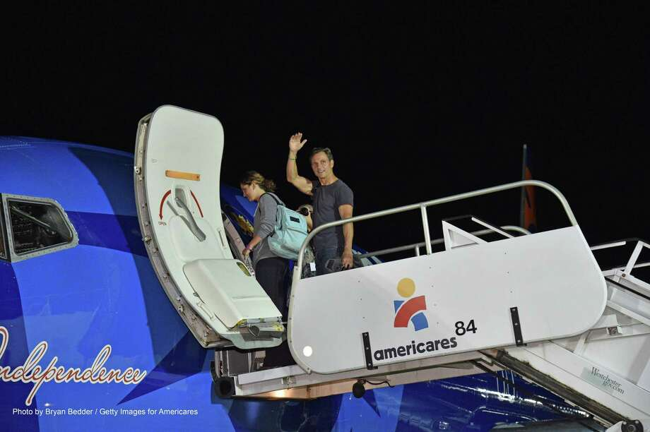Actor and Americares ambassador Tony Goldwyn and his daughter Tess board the Americares plane en route to Guatemala at Westchester CountyAirport on Oct. 14. Photo: Bryan Bedder / Getty Images For Americares / 2017 Getty Images