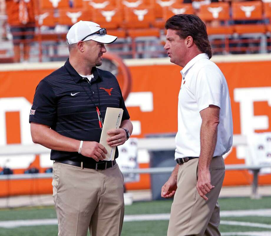 Texas head coach Tom Herman, left, talks with Oklahoma State head coach Mike Gundy, right, before the start of an NCAA college football game, Saturday, Oct. 21, 2017, in Austin, Texas. Photo: Michael Thomas, AP / FR65778 AP